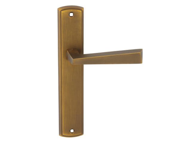 Klamka drzwiowa KYRK szyld długi bez otworu brąz złocisty Domino